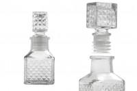 Flacon de 60 ml miniature 106x44 mm avec dessins en relief et bouchon en verre