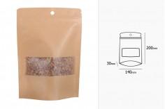 """Σακουλάκια κραφτ τύπου Doy Pack, με κλείσιμο """"zip"""" και παράθυρο, εσωτερική και εξωτερική διάφανη επένδυση, στρογγυλή τρύπα και δυνατότητα σφράγισης με θερμοκόλληση 140x30x200 mm - 100 τμχ"""