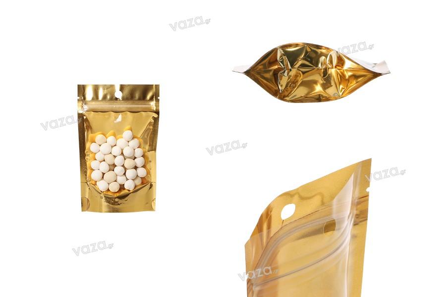"""Σακουλάκια τύπου Doy Pack 90x30x140 mm αλουμινίου με χρυσή πίσω πλευρά, διάφανο μπροστά με κλείσιμο """"zip"""" και δυνατότητα σφράγισης με θερμοκόλληση - 100 τμχ"""
