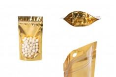 """Σακουλάκια τύπου Doy Pack 100x30x180 mm αλουμινίου με χρυσή πίσω πλευρά, διάφανο μπροστά με κλείσιμο """"zip"""" και δυνατότητα σφράγισης με θερμοκόλληση - 100 τμχ"""