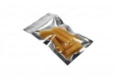 Sachet en plastique avec fermeture à glissière, argenté à l'arrière et transparent au devant, et avec la possibilité de thermocollage 70X130mm- paquet de 100 pièces