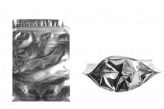 Sachet en plastique type Doypack avec fermeture à glissière, argenté à l'arrière et transparent au devant et avec la possibilité de thermocollage 140X40X200mm- paquet de 100 pièces