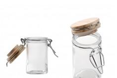 Βάζο 60 ml γυάλινο στρογγυλό 85x45 mm με ξύλινο καπάκι και αεροστεγές κλείσιμο (σύρμα και λάστιχο στο καπάκι)